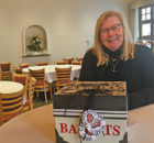 Anne Gamache, co-founder of Women Who Care, sets up for the organization's meeting at Alpenrose Restaurant in Holland