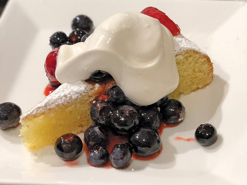 citrus almond cake with warm berry compote