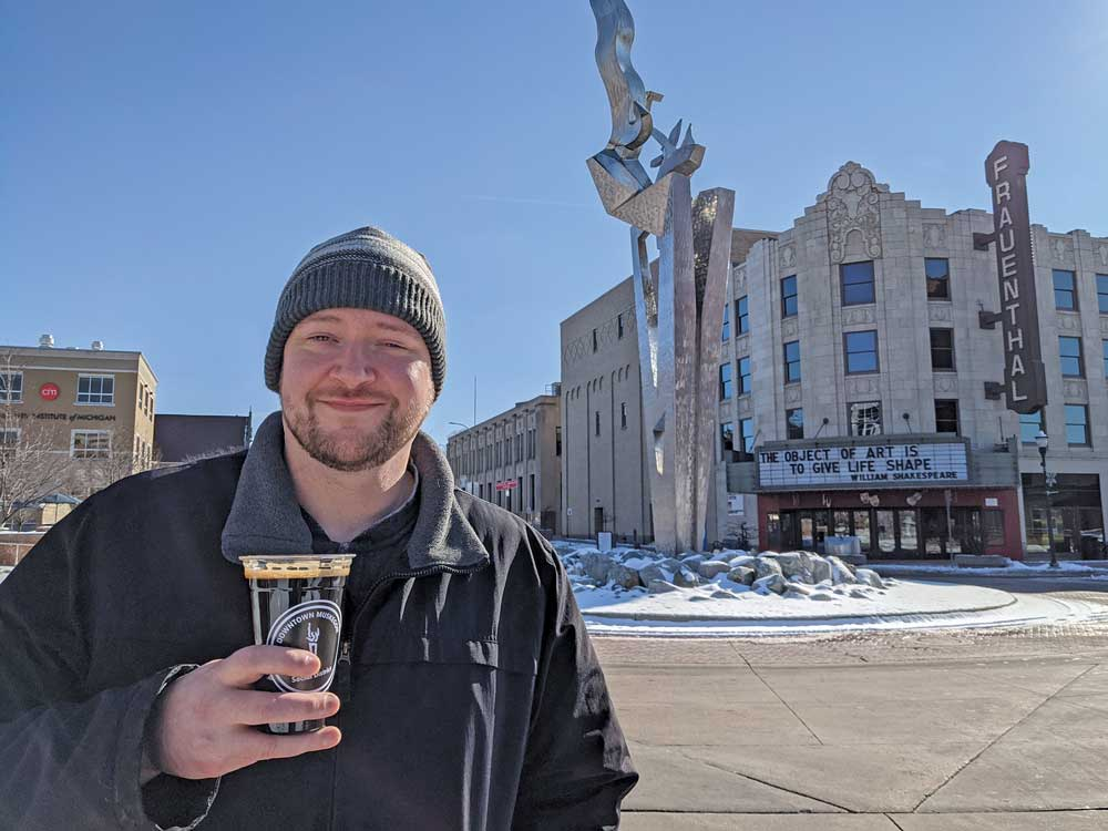 Contributor Aaron Ogg enjoys a Foundry Slag from Unruly Brewing near Frauenthal Theater in the Downtown Muskegon Social District